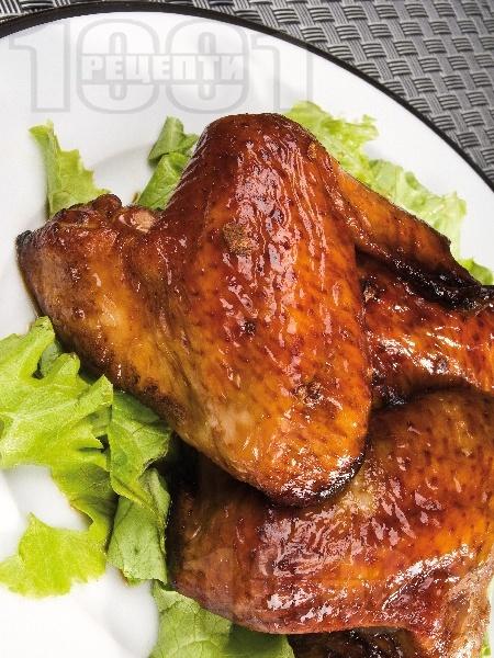 Вкусни сочни печени мариновани пилешки крилца със соев сос, бяло вино, чесън и кимион на фурна - снимка на рецептата